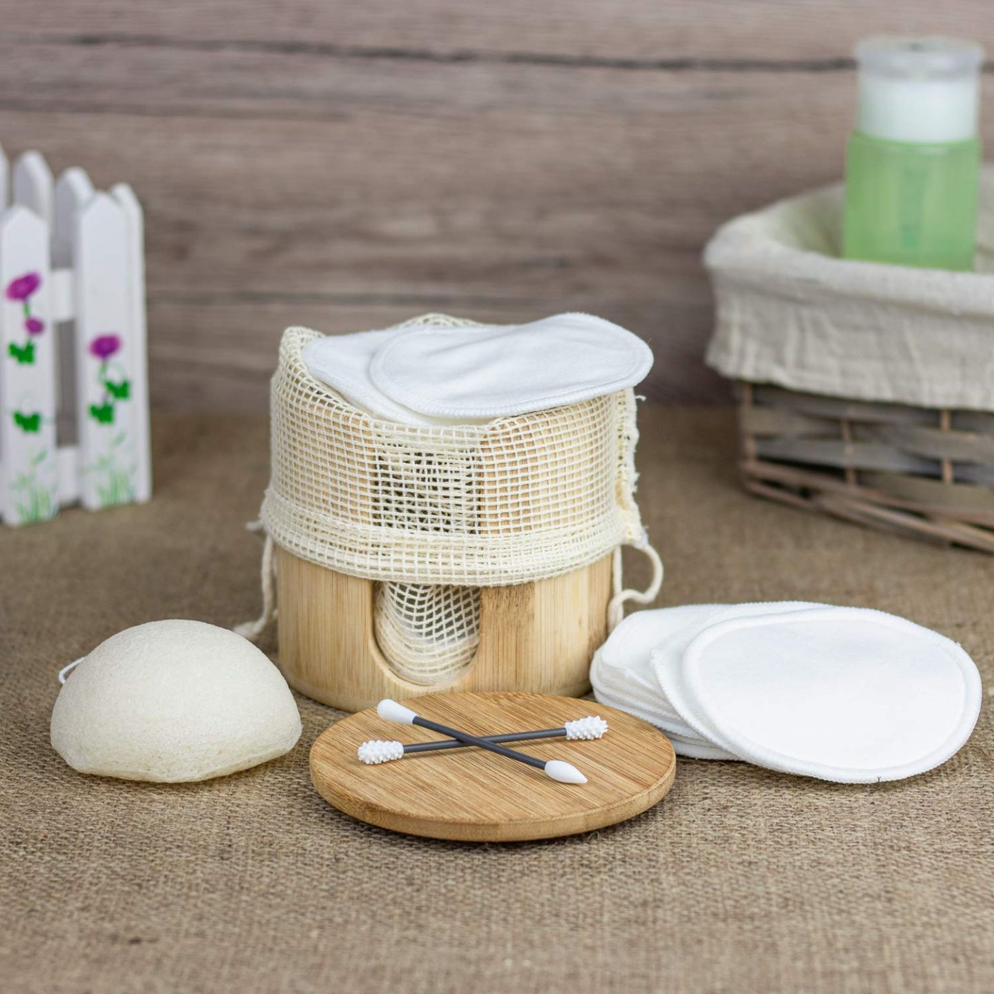 Adbra reusable cotton pads in a wooden storage jar