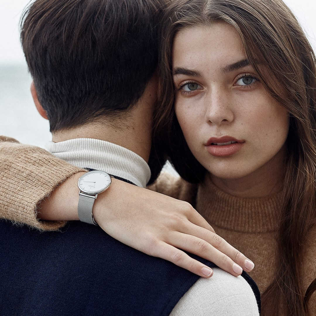 Man and woman wearing Nordgreen watch