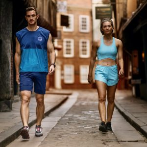 White man and woman wear Mocean Fitness activewear