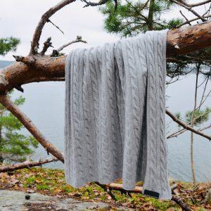 KIND&KOZY grey blanket draped over tree branch