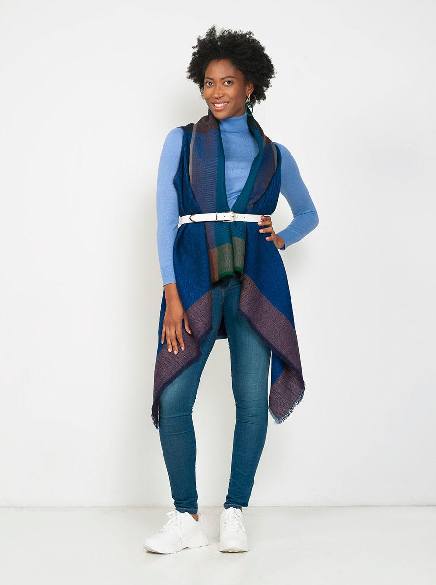 Black woman wears Fifth Origins cape