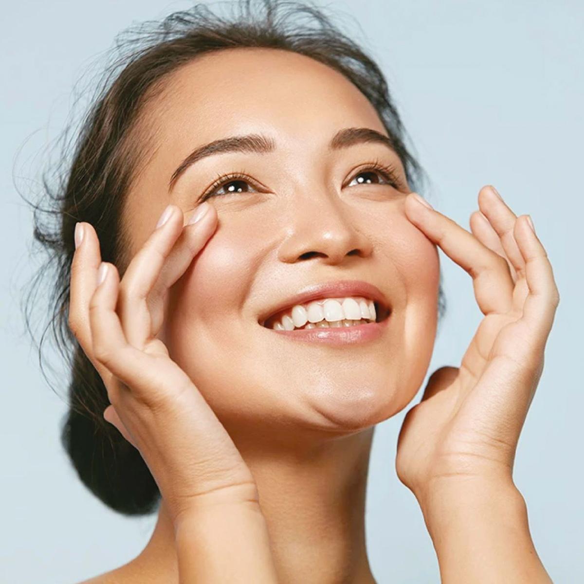Woman applying Peace & Pure skincare