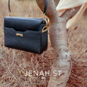 Jenah St. Bag hanging from tree branch
