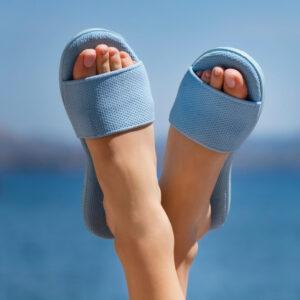 Aplo Sandals in blue shown on feet