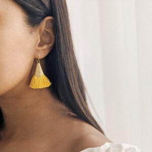 Woman wears SO JUST SHOP earring