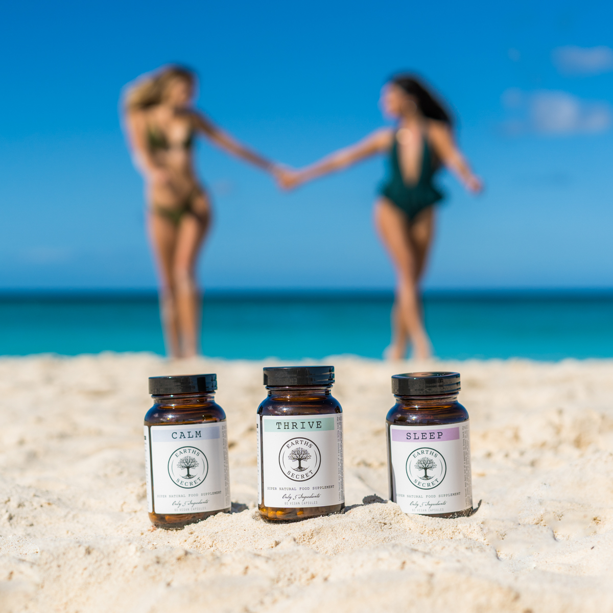 Earths Secret Products with two women holding hands on a beach