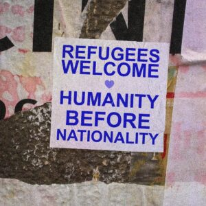 Poster with text: Refugees Welcome. Humanity Before Nationality