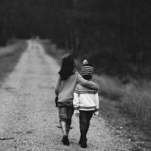 Two children walking outdoors