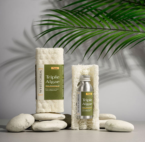 Two Whitfords products shown with pebbles and leaf